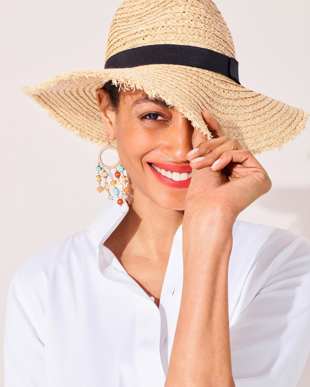 Woman wearing a Chico's straw hat