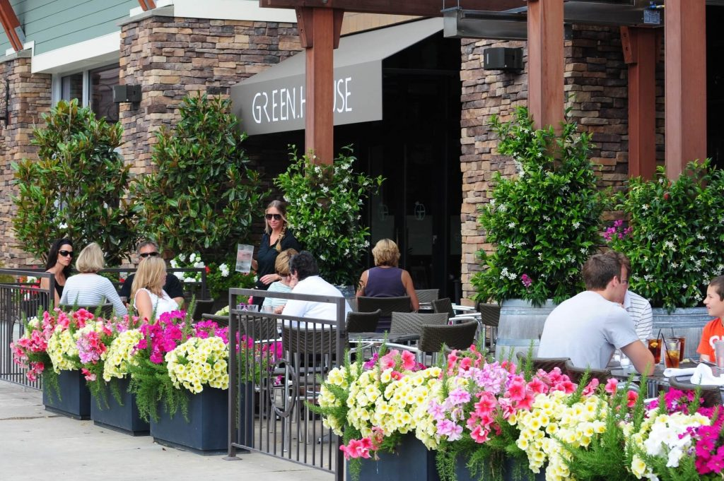 People dining outdoors at Green House restaurant at Uptown Gig Harbor in Gig Harbor, WA.