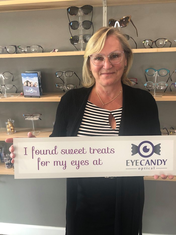 Client wearing new glasses at Eye Candy Optical in Gig Harbor